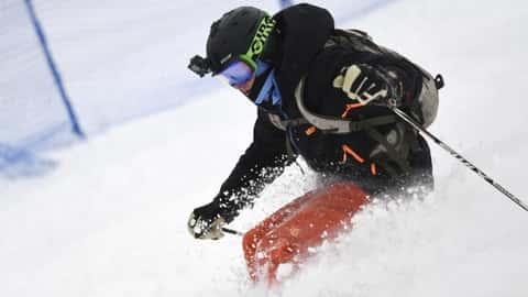 Kimber Bogush from Castle Rock skis ...