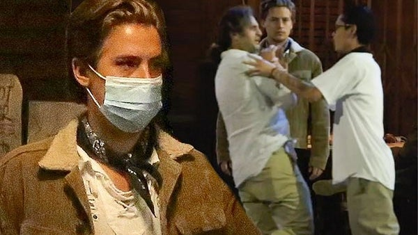 Riverdale star Cole Sprouse holds back friend from a street fight outside a restaurant in LA