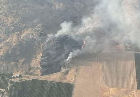 Firefighters stop forward progress of wildfire burning near Orange Cove