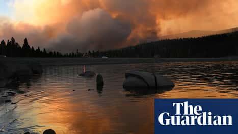 Caldor fire: changing winds offer hope as firefighters battle blaze near Lake Tahoe
