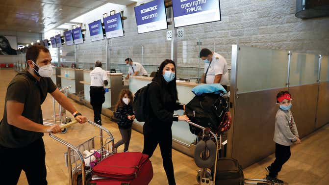 Israel cancels travel quotas, sets new coronavirus rules for airport
